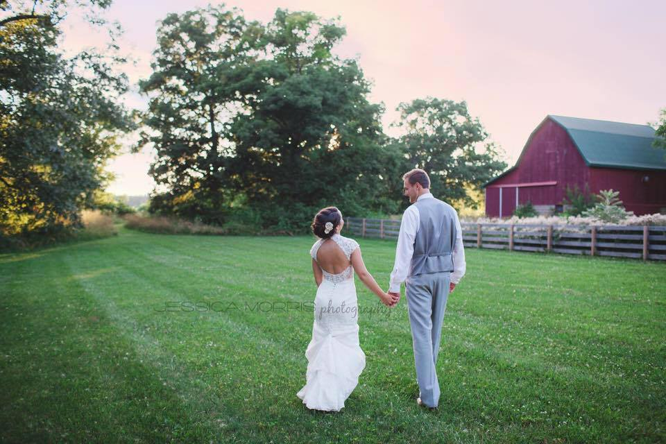 Bride And Groom Holding Hands At Barn Wedding Venue The Hawks Point In Anderson