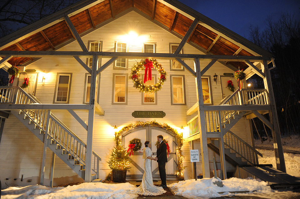 Bride and groom holding hands at rustic wedding venue Christmas Farm Inn & Spa in Jackson, NH