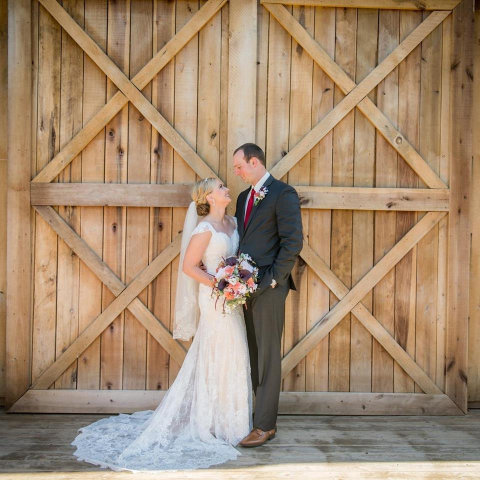 Bride and groom at Indianapolis barn wedding venue The Barn at Hawks Point