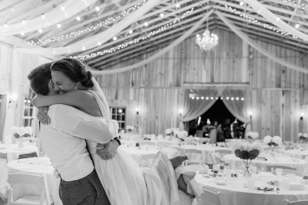 Bride and groom hug at Indiana barn wedding venue The Barn at Hawks Point