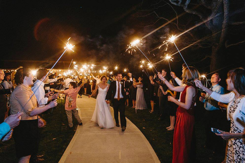 Rustic wedding sparklers at Indianapolis barn wedding venue The Barn at Hawks Point