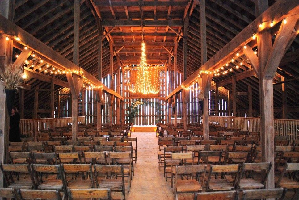 Wedding ceremony at barn wedding venue Barn on Boundary in Eaton, Indiana