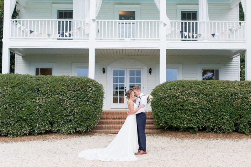 bride and groom at rustic wedding venue in north carolina