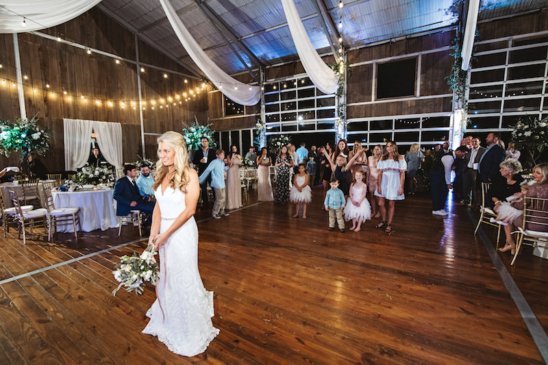 Wedding bouquet toss at a barn wedding, Spring Creek Ranch in Tennessee