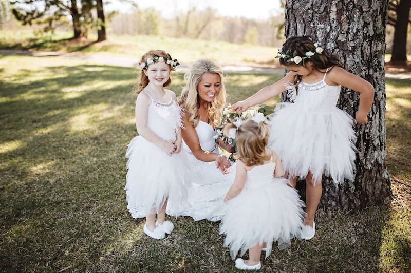 Bride and flower girls at barn wedding venue Spring Creek Ranch in Tennessee
