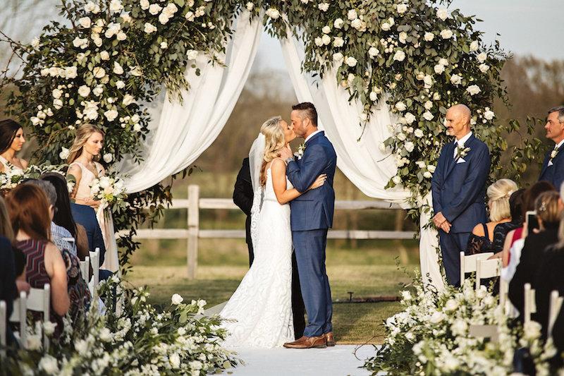 Rustic outdoor wedding ceremony at barn wedding venue Spring Creek Ranch in Tennessee