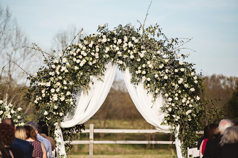 Rustic ceremony flowers at a rustic outdoor wedding ceremony at Spring Creek Ranch in Tennessee