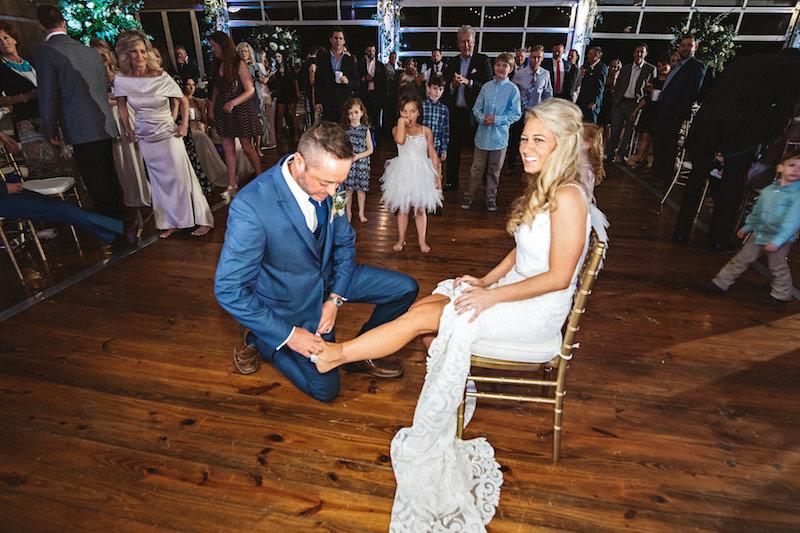 Wedding garter toss at a barn wedding venue, Spring Creek Ranch in Tennessee