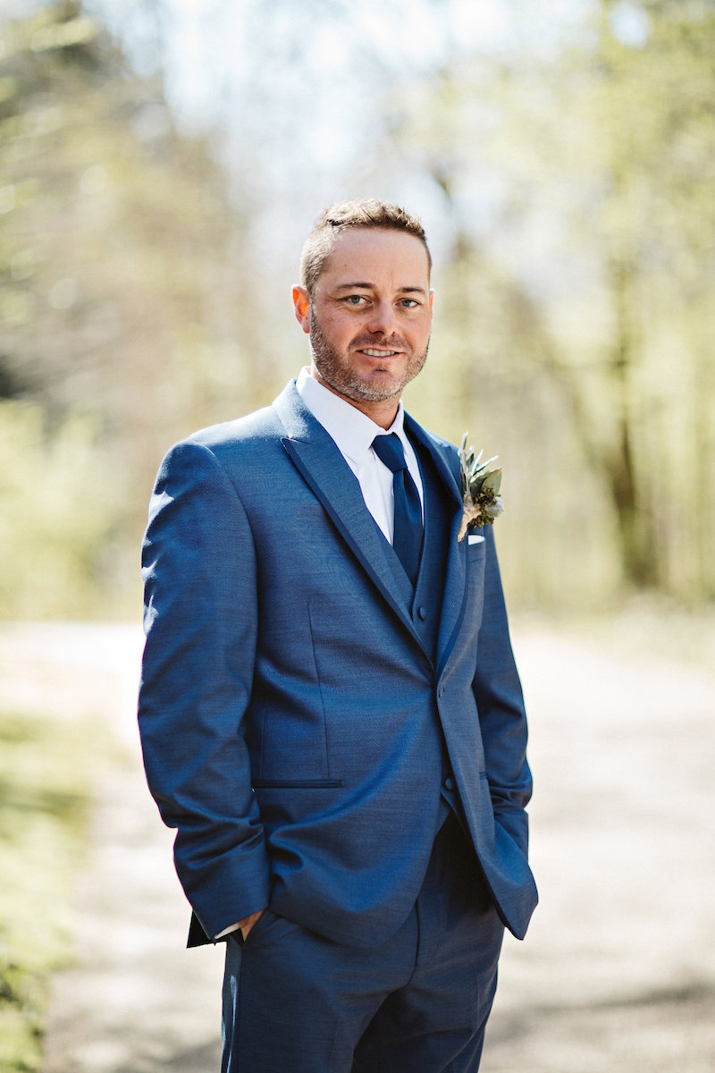 Groom at barn wedding at Spring Creek Ranch in Tennessee