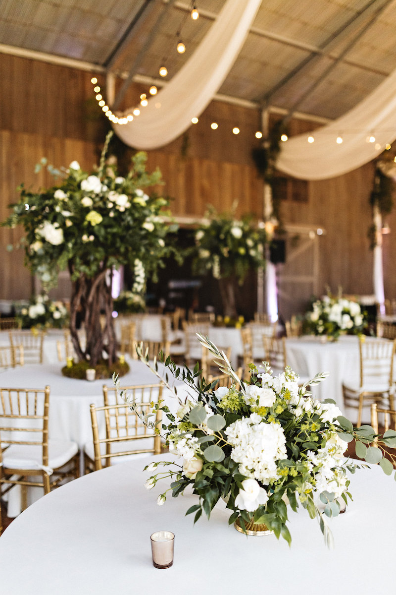 White flower centerpiece at barn wedding at Spring Creek Ranch in Tennessee