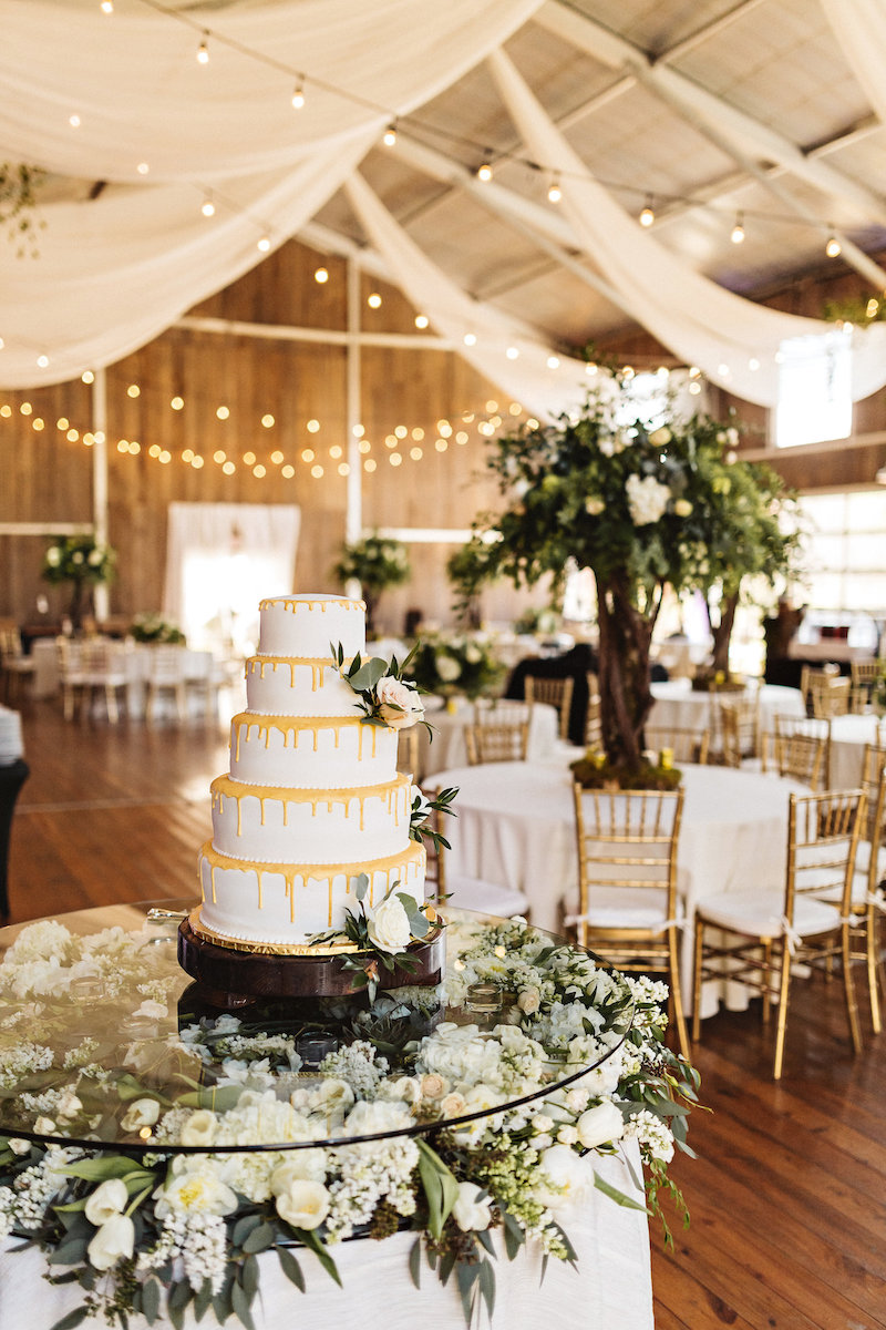Yellow and white wedding cake at barn wedding at Spring Creek Ranch in Tennessee