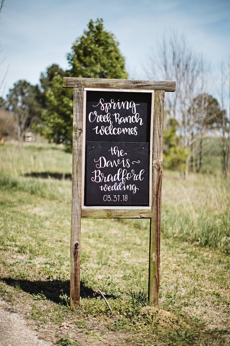 Rustic wedding welcome sign at barn wedding venue Spring Creek Ranch in Tennessee