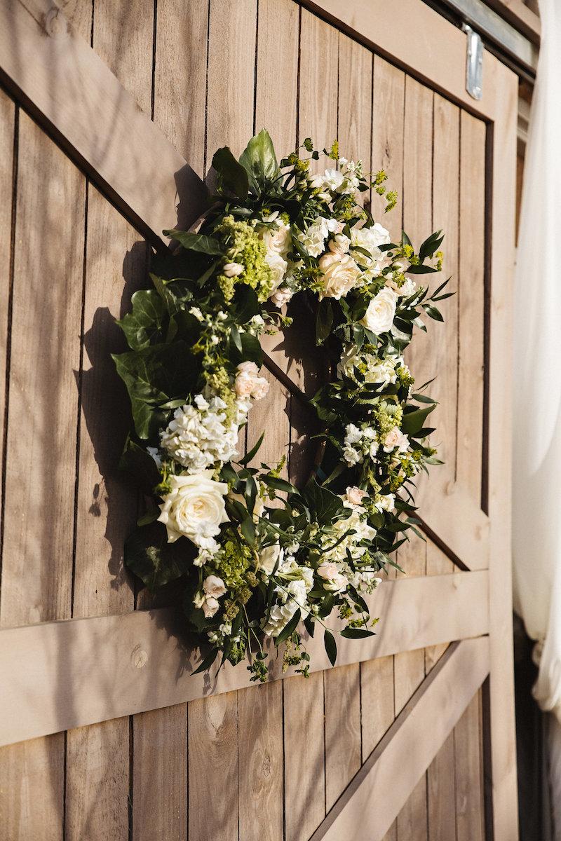 Wedding flower wreath at barn wedding venue at Spring Creek Ranch in Tennessee